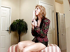 Spicy milf Dee Dee licks the shaft of the dildo she is about to plunge in her pussy