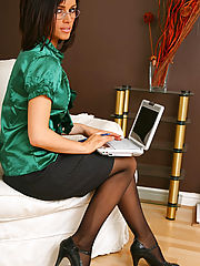 Sexy brunette secretary Gemma Massey relaxes on her sofa in nothing but gorgeous opaque pantyhose