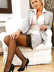 Delightful blonde secretary Lucy Zara gets comfortable as she peels of her suit and relaxes in a sexy set of stockings and suspenders
