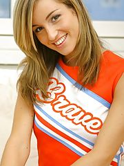 Melanie in a cheerleader outfit with dark tan stockings