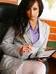 Sex in Office, Beautiful brunette secretary Laura A strips from her cute grey suit and purple shirt to give us a glimpse of her sexy white lingerie