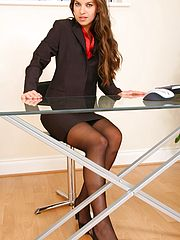 Sex Office, Michaela looks delightful as she slowly removes her sexy skirt suit to reveal her gorgeous black stockings and suspenders