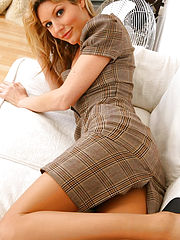 The delightful Nicole teasing her way out of her checked secretary outfit revealing her beige pantyhose
