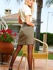 Beautiful blonde Maria seductively strips from her sexy secretary outfit